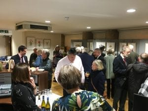 Guests gathered in our reception area enjoying mince pies and wine